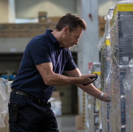 man scanning boxes